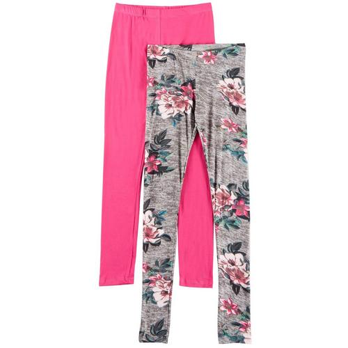 1st Kiss offers styles for the fun, free-spirited trendsetter. This two pack of leggings feature a pair of large floral print leggings and a bright solid pair of leggings with elastic waists and a close, flattering fit.