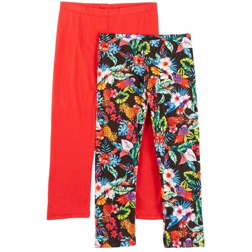 1st Kiss offers styles for the fun, free-spirited trendsetter. This two pack of leggings feature a pair of colorful tropical print leggings and a solid pair of leggings with elastic waists and a close, flattering fit.