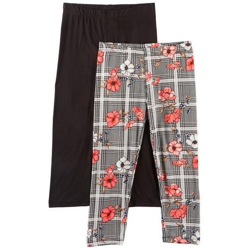 1st Kiss offers styles for the fun, free-spirited trendsetter. This two pack of leggings feature a vibrant pair of plaid & floral print leggings and a solid pair of leggings with elastic waists and a close, flattering fit.